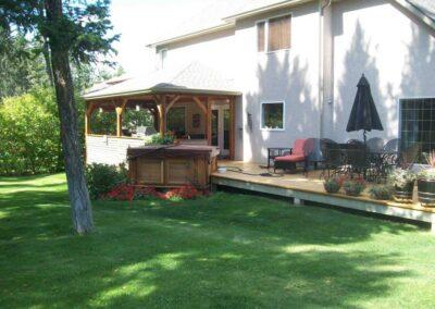 arctic spas hot tub in red cedar cabinet in backyard