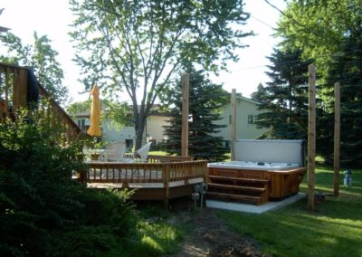 Arctic Spas hot tub in red cedar cabinet in garden
