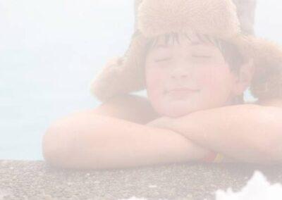 Boy relaxing in Arctic Spas hot tub in winter