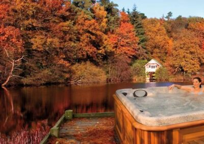 Woman relaxing in a hot tub in autumn