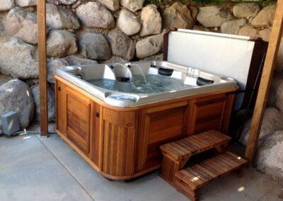 Arctic Spas hot tub in no maintenance red cedar cabinet
