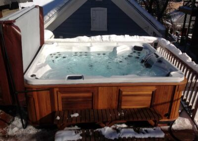 Arctic Spas hot tub in red cedar cabinet on the terrace in winter