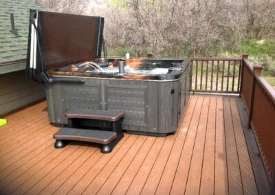 Arctic Spas hot tub in charcoal no maintenance cabinet on the deck