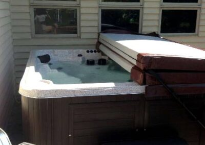 Arctic Spas hot tub in no maintenance cabinet on the patio