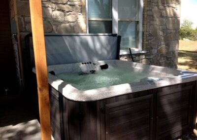 Arctic Spas hot tub in sable no maintenance cabinet in the backyard