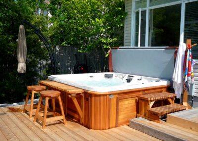 arctic spas hot tub in red cedar cabinet in pool deck