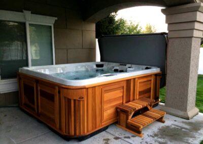 Arctic Spas hot tub in a cedar red cabinet