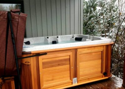 total access in a red cedar cabinet on the deck in winter