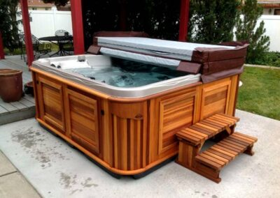 half open Arctic Spas hot tub in the backyard